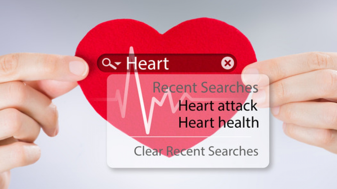 Female hands holding heart and heartbeat symbol with search engi
