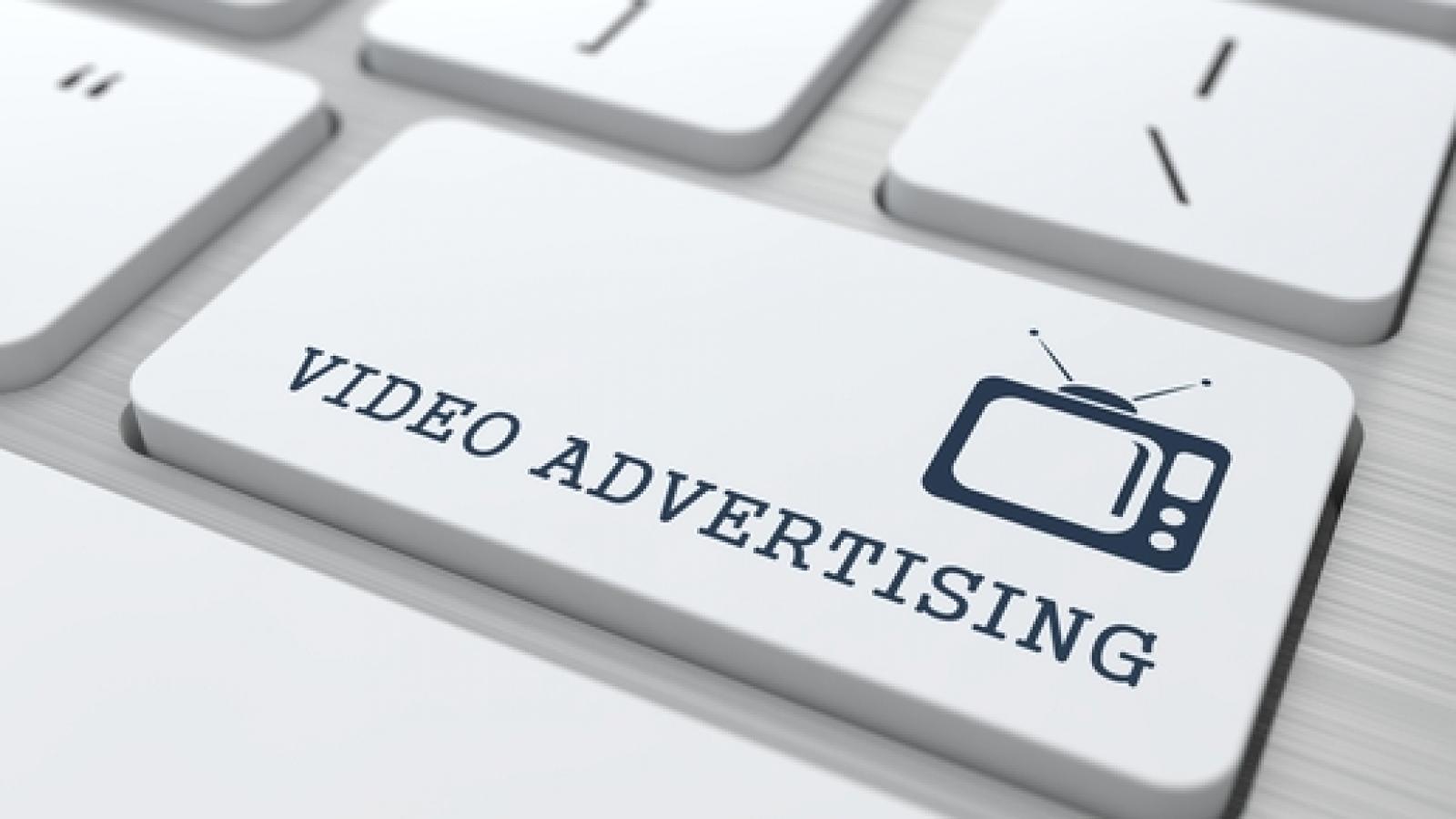 Video Advertising on White Keyboard Button.